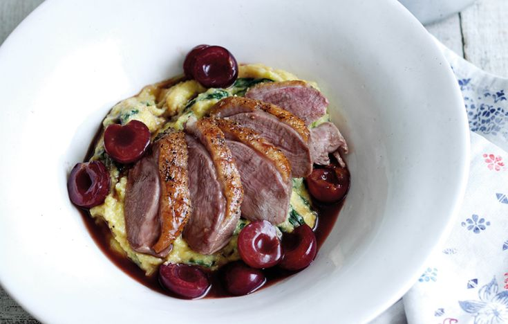 Crispy skin duck breast with cherry sauce, spinach and polenta