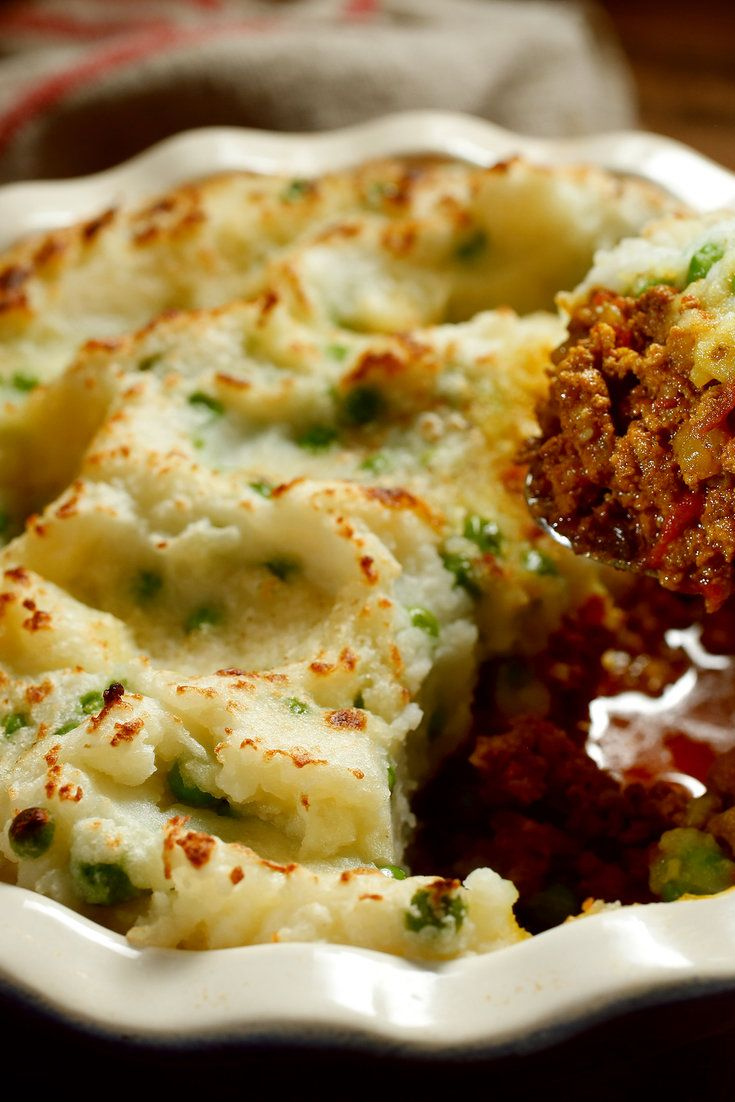 NYT Cooking: This spiced version of the traditional English dish was developed in 1984 by Pierre Franey and Craig Claiborne for an article about budget-friendly meals. Here, the ground beef base is laced with curry powder, cumin and coriander then topped with a pile of fluffy, mashed potatoes dotted with green peas.