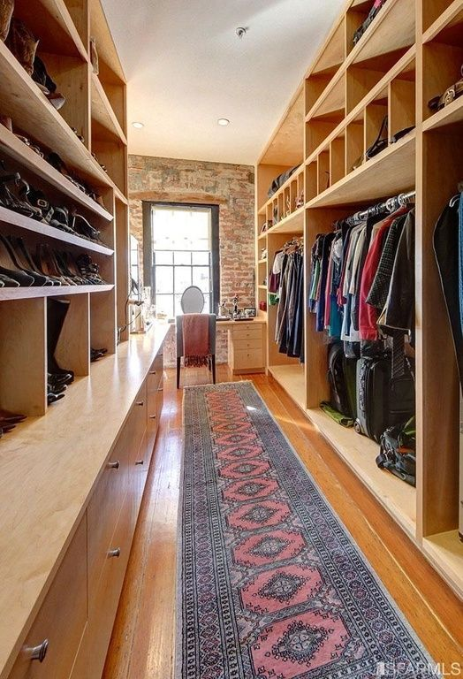 Contemporary Closet With Hardwood Floors High Ceiling