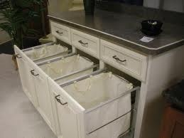 Built in laundry sorting in under cabinets, But, I like the idea of this for the kitchen but for recyclables.