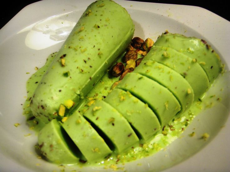 Pista Kulfi ~    Evaporated Milk: 2 cups. Condensed Milk: 2 cups. Whipped Cream: 16 Oz. Ground Green Cardamom Powder: ½ tsp. Green sliced Pista (pistachio): ½ cup.