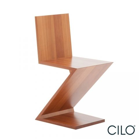 Stoel ZigZag Cassina  De Gerrit Rietveld ZigZag stoel is een echte designklassieker. De ZigZag is, naast de Red Blue chair, één van de bekendste ontwerpen van Gerrit Rietveld.  De ZigZag stoel heeft een hoge zitting en geen armleuningen. De ZigZag is opgebouwd uit aan elkaar gelijmde massief houten platen iepenhout met een dikte van 18 mm.  Hoogte: 74 cm Breedte: 37 cm Diepte: 43 cm Zithoogte: 43 cm