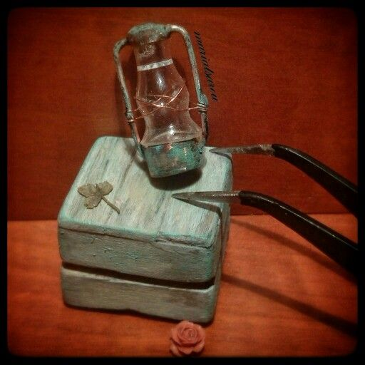 handmade miniature latern, vintage oil lamp made with copper soldering and the glass is the upper part of a vial