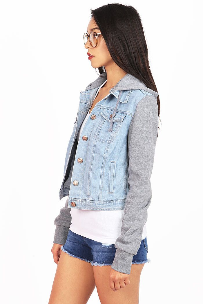 Classic denim jacket with metal buttons down the center and front flip pockets. Soft heather sleeves with a detachable hoodie. Easily pair with any casual outfit. *Machine Wash Cold *71% Cotton/21% Po