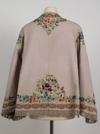 Jacket (back), circa 1865, grey wool, silk embroidered short, loose fitting paletot with concealed front fastening. Open half way up sides. Pagoda sleeves, fringed at hem and sleeves. Lined in grey silk. Killerton Fashion Collection © National Trust / Sophia Farley and Renée Harvey
