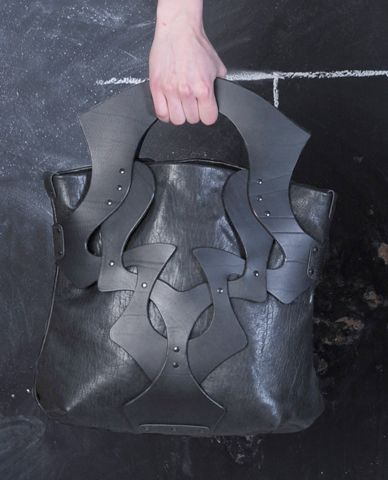 Edgy leather tote with stud detail. Anuk Harvey.