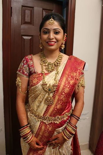 South Indian bride in a resplendent silk sari and gold temple jewellery.