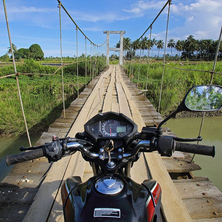 Motorbike touring on Nias Island. The main roads along the coast are good, but many of the smaller roads in the interior of the island offers some good off-road adventures. Photos by Bjorn Svensson. www.visitniasisland.com