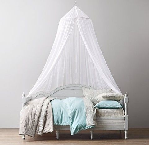 Simple drama with a canopy over a day bed, maybe for a
