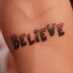 BELIEVE - that's Justin Bieber's tattoo....don't ask me how I know that.