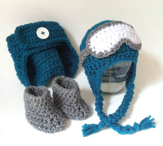 Very cute complete prop set! Earflap style snowboarding/ski hat with goggles, coordinating grey booties, and adjustable teal diaper cover Would