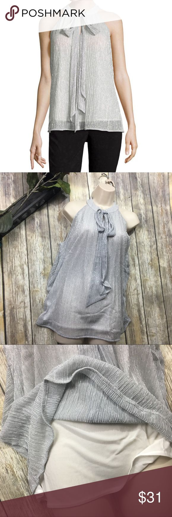 Worthington Polar Bear Silver Blouse Polar Bear Silver Chiffon Bow Blouse.Size XLT . New with tag. versatile tieing material around front of neck. . 30 inches long.. 22 inch bust line. Gorgeous Halter style neck line. Fully lined . Polyester blend material Worthington Tops Blouses