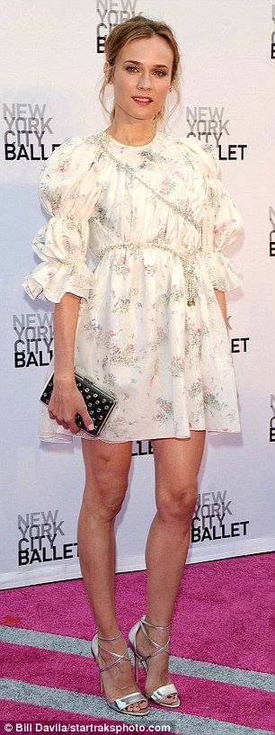 Pale and dramatic: While Diane Kruger wowed in her white sprigged frock…