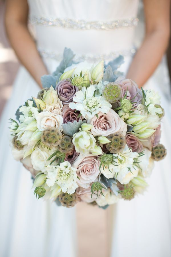 Paradise Valley Wedding Inspiration - For the bridal florals we used a hand tied bouquet featuring Amnesia roses, champagne quicksand roses, ivory spray roses, white scabiosa, and scabiosa pods.