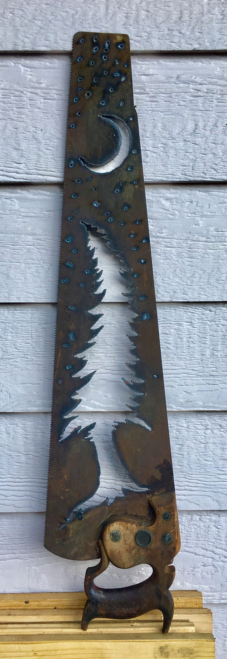 Old hand saw cut with plasma cutter.  Nighttime tree scene in negative. Commissioned piece.  Made by Roshi