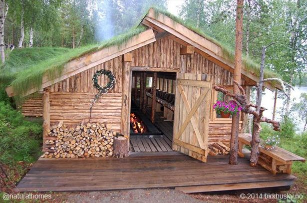 One Of The Log Longhouse Cabins With A Long Central