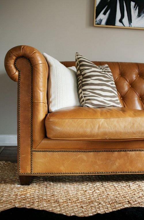 Camel Colored Leather Chesterfield Sofa Zebra Pillows Jute Rug Hide