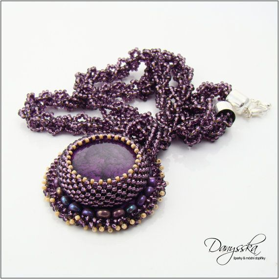 The necklace is made of czech seed beads Preciosa, japanese TOHO beads and purple cabochon.    It is 46 cm (18.11 inches) long and it can be extended to 51 cm (20.07 inches) using an extender chain.     The pendant has 4.3 cm (1.69 inches) in diameter. It is backed with felt.    Lobster clasp with extender chain.    Specification:    - color: purple  - length: 46 cm (18.11 inches), max. 51 cm (20.07 inches)  - size of the pendant: 4.3 cm (1.69 inches)  - material: czech seed beads Preciosa…