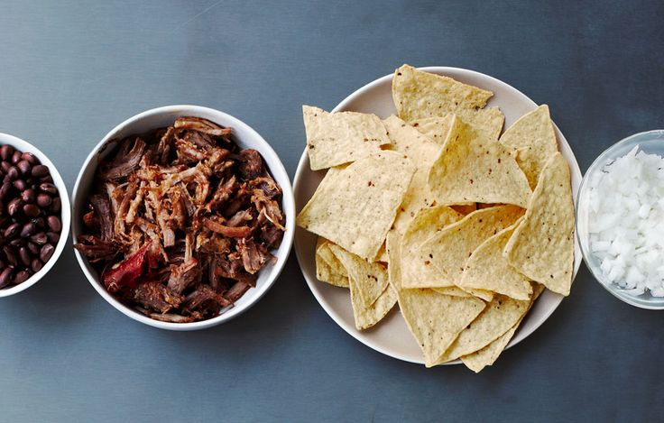 Use a lager to tenderize the pork shoulder in these carnitas.