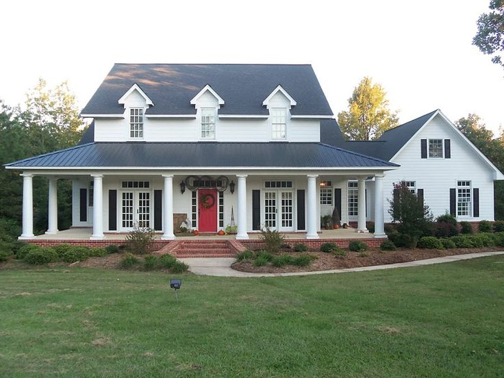red door, wrap around porch, all that's missing is a mountain right behind it and this is my dream home!