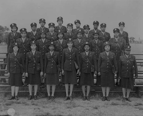 Photo of 24 Black nurses who were sent to England to help care for German POWs during WWII. The 1944 deployment of these nurses was a long-time effort to get African American nurses to serve outside of Black regiments. Doretha Anderson (2nd row, 3rd from the right) was one of these nurses. She died on August 19, 2013 at the age of 98.