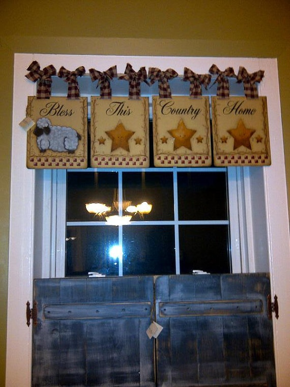 Love the shutters! And the wooden signs as a valence - brillant!