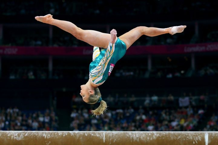 Australia's Emily Little competes on the beam in the Artistic Gymnastics Women's Team qualifying event.