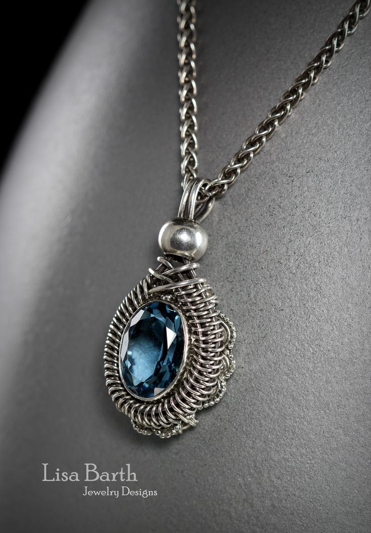 A re-purposed ring I made into a pendant.  Hand woven sterling with a blue Topaz stone.  Lisa Barth