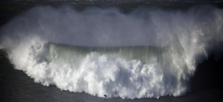 A surfer drops in on a large wave at Praia do Norte, in Nazare, December 11, 2014. Big-wave surfer Garrett McNamara scoured the world for the biggest waves to surf. He calls Portugal's Nazare coast the 'Holy Grail of huge waves'. (scheduled via http://www.tailwindapp.com?utm_source=pinterest&utm_medium=twpin&utm_content=post320771&utm_campaign=scheduler_attribution)