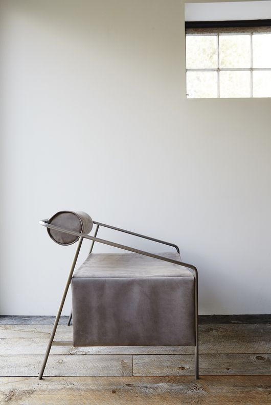 Bolster-backed, smoky nubuck chair created by Farrah Sit in collaboration with leather handbag designer Anna Moss of Chiyome.