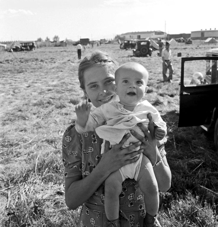 At a carrot-pickers camp. Depression era photo by Dorothea Lange.