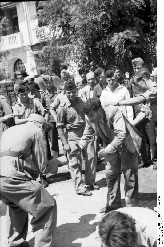 Thessaloniki, Greece, July 1942: Jewish man is forced to perform calisthenics on the day all Jewish men were ordered to a city square to be put to hard labor. They were made to wait for hours in the burning sun and perform calisthenics or dance. This was a precursor of sending the entire Jewish population of the city to the death camps.