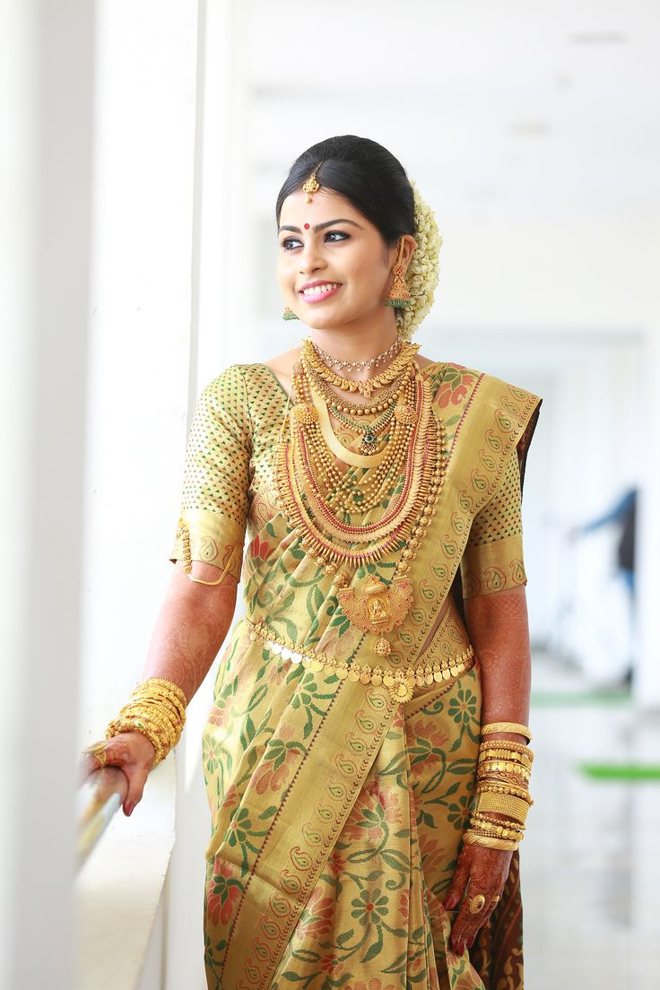 South Indian bride.Gold Indian bridal jewelry.Temple jewelry. Jhumkis. Gold silk kanchipuram sari.Braid with fresh flowers. Tamil bride. Telugu bride. Kannada bride. Hindu bride. Malayalee bride.Kerala bride.South Indian wedding.