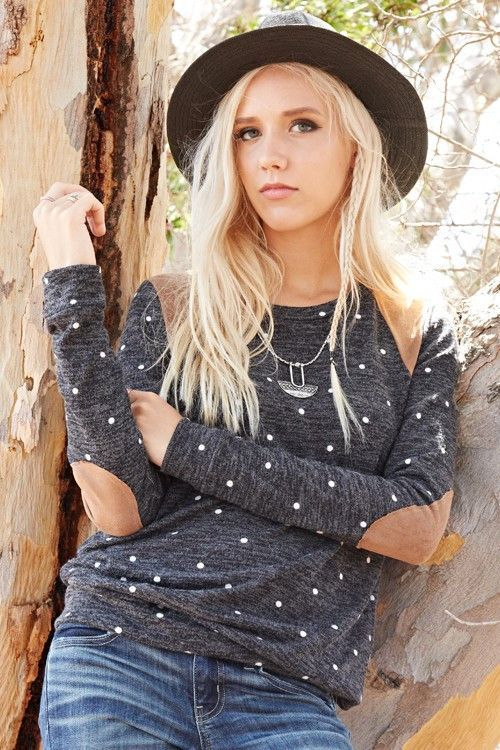 Charcoal, suede patch paneled polka dot print knit top with suede elbow patches and long sleeves. 96% Polyester 4% Spandex.