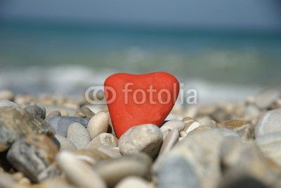 Red stone hearth on pebbles, symbol of love and peace