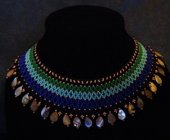 Egyptian style beaded collar necklace with a cut shell border.  www.facebook.com/teristreasures