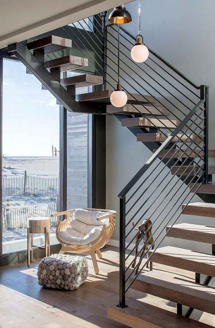 Wood and steel stairs lead to the