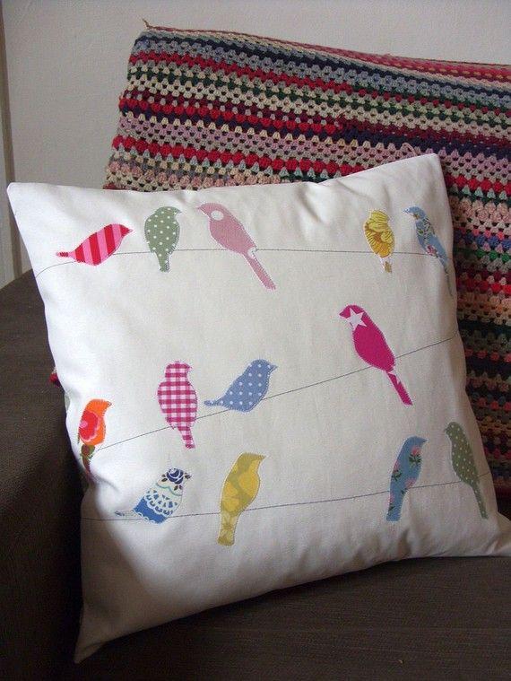 Birds on a wire cushion.