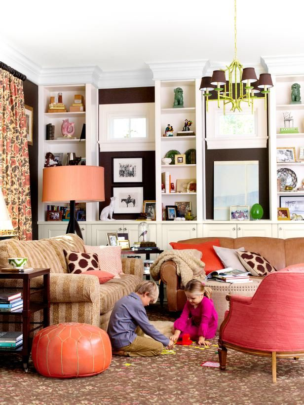 Family Room: Floral Curtains + Striped Sofa + Orange and Green in Mixing Paint Colors and Patterns from HGTV