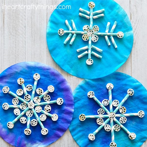 Painted coffee filters, pinwheel pasta and paper straws come together to create awesome texture in this fun kids snowflake craft.