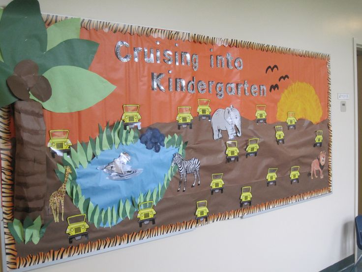 """My pride and joy! """"3D"""" safari bulletin board outside of my room: Cruising into Kindergarten. Each student's picture is now behind one of the jeeps! LOVE!"""