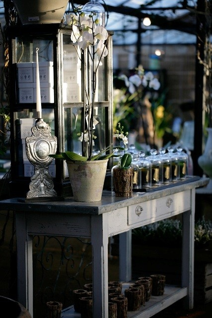 Potting tables, like this one, can also be used as a decorative accessory in the garden.  Petersham Nurseries