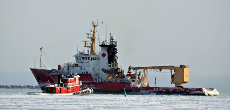 The Canadian Coast Guard Icebreaker the SAMUEL RISLEY and local Tugboat GEORGE N. CARLETON clear ice in The Bay for the departure of the Algowood...January 9th 2015..