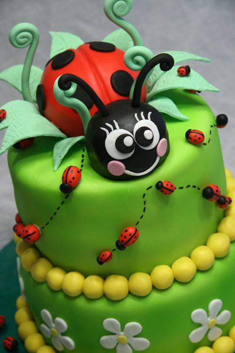 """Ladybug - My friend saw this design by Fantasticakes and wanted it so badly! Since we're in different continents, I hope she doesn't mind I copied her design. It's just so adorable! 9"""" & 7"""" rounds covered in fondant and airbrushed. Ladybug is rice krispie treats covered in fondant. :-)"""