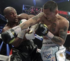 Floyd Mayweather Jr. expondrá sus títulos de peso welter y superwelter de Consejo Mundial de Boxeo (CMB) en su pelea contra el argentino Marcos Maidana, el próximo 13 de septiembre en Las Vegas, informó hoy el organismo.