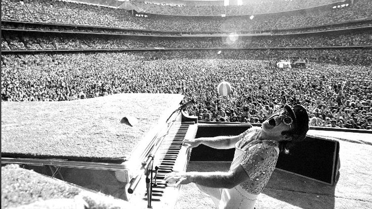 25 Incredible Band Photos That Will Restore Your Faith In Good Music. This is Elton John in Dodger Stadium, 1975.