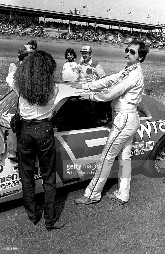 Dale Earnhardt Sr. and his wife, Teresa Earnhardt, stand beside the #15 Wrangler Ford Thunderbird prior to the start of the 1982 Daytona 500 at the Daytona International Speedway on February 14, 1982 in Daytona Beach, Florida.
