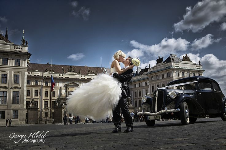 Bride and groom having wedding photo shoot at Prague Castle - Vintage wedding car photo