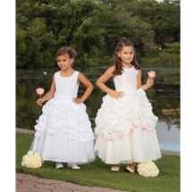 Flower Girl Dress style 449 has a taffeta bodice, with a taffeta and tulle skirt. Permanent gathered waistband. Half pick up skirt with detachable rosettes. Sash and rosette sets S180 and S181 sold separately. It is a very popular flower girl dress that can be found at www.SweetiePieCollection.com