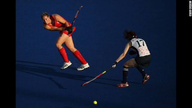 Crista Cullen of Great Britain competes against Masako Sato of Japan during a women's field hockey match. http://www.PaulFDavis.com/success-speaker (info@PaulFDavis.com)